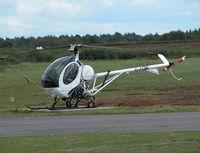 G-FCBI @ EGHH - Schweizer 269 outside the Flying Club - by BIKE PILOT