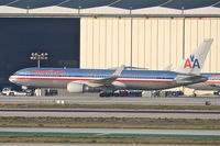 N381AN @ KLAX - American Airlines Boeing 767-323, getting a tow to the AA maintenance hangar at KLAX. - by Mark Kalfas