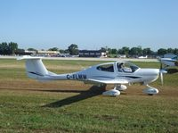C-FLMW @ KOSH - Diamond DA40 - by Mark Pasqualino
