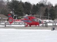 C-FJDZ - Eurocopter EC120B landed on frozen docks in Muskoka Bay, Lake Muskoka. - by Grant Cleveland