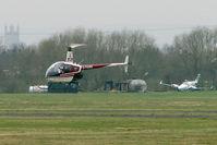 G-TGRE @ EGBJ - 1985 Robinson Helicopter Co Inc ROBINSON R22 ALPHA, c/n: 0471