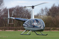 G-BZGO @ EGCB - 2000 Robinson R44 Astro, c/n: 0757 at City of Manchester Airport - by Terry Fletcher