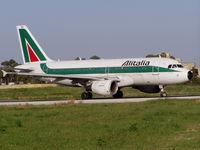 I-BIMD @ LMML - A319 I-BIMD Alitalia lining up for departure - by raymond