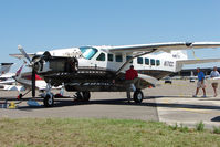 N171CC @ KLAL - Sad demise for this great looking Caravan - when storms passed though Lakeland at 2011 Sun n Fun