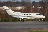 N843LX @ ORF - Oklahoma Garages LLC 1996 Raytheon Hawker 800XP N843LX from Southwest Florida Int'l (KRSW) rolling out on RWY 23 after landing.
