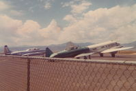 N3151G @ KBJC - Photographed from a car window, cropped from a 126 3X5 photo. - by Glenn E. Chatfield