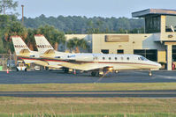N667QS @ KJAX - 2004 Cessna 560XL, c/n: 560-5365 and sistership N604QS on the Jacksonville In biz ramp in fading light