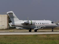 4X-CMY @ LMML - CL600 Challenger 4X-CMY Noy Aviation - by raymond