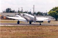 N122V @ OPF - Florida Air Cargo - by Henk Geerlings