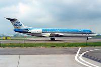 G-UKFG @ EHAM - Fokker F-100 [11275] (KLM) UK Amsterdam -Schiphol~PH 10/08/2000