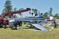 N5627A @ LAL - Storm damage to 55 year old Cessna 172 - Sun n Fun 2011 at Lakeland , Florida - by Terry Fletcher