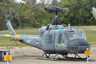 151268 @ NPA - 1964 Bell UH-1E Iroquois, c/n: 6003 in outside storage at Pensacola Naval Museumm
