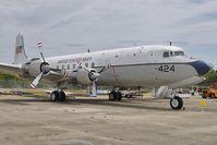 128424 @ NPA - 1951 Douglas C-118, c/n: 43207 in outside storage at Pensacola Naval Museum