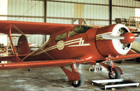 N65596 @ ORL - Beech D17S Staggerwing of Rosie O'Grady's Flying Circus at Herndon in November 1979. - by Peter Nicholson