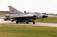 22 @ WTN - Saab Draken of the Austrian Air Force taxying to the active runway at RAF Waddington in May 1995. - by Peter Nicholson