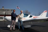 N126WK - accepting the keys for N126WK from John Rathmall - by Walter Eckmeier