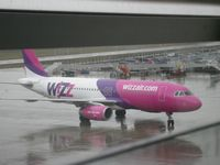 HA-LPC @ EGGW - Taken on a wet February morning at Luton whilst waiting to fly to Cyprus - by Steve Staunton
