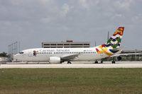VP-CKZ @ MIA - Caymen 737-300