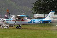 G-BHDM @ EGBP - R/Cessna F.152 [1684] Kemble~G 01/07/2005.Taken in rain. - by Ray Barber