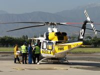 N120LA @ POC - Loading up a patient to fly to a trauma center - by Helicopterfriend