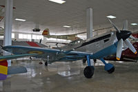 C4K-158 @ LECU - Colorful Spanish-built Me-109, powered by a British Rolls-Royce Merlin. - by Daniel L. Berek