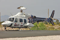 N429MA @ NV40 - 1984 Bell 222UT, c/n: 47523 of Mercy Air on the Action Helipad , just south of Henderson NV