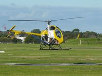 VH-HYD @ YMMB - Schweizer 269C VH-HYD hovering over the heliport preparing to depart at Moorabbin