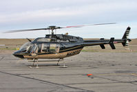 N428TG @ CNY - Bell Helicopter Textron Canada 407, c/n: 53884 refuels at Moab - by Terry Fletcher