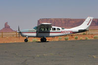 N9317M @ UT25 - 1980 Cessna T207A, c/n: 20700680 taking off down the slope at Monument Valley Airport