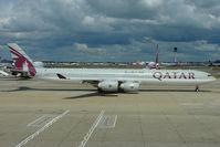 A7-AGB @ EGLL - 2005 Airbus 340-642, c/n: 715 of Qatar Airways taxying at Heathrow T4