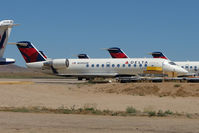 N595SW @ IGM - 1999 Bombardier CL-600-2B19, c/n: 7292 WFU at Kingman