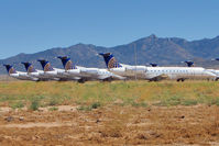N24517 @ IGM - 2000 Embraer EMB-135LR, c/n: 145332 at front of this line of stored CO EMB145s at Kingman
