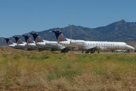 N25504 @ IGM - 1999 Embraer EMB-135ER, c/n: 145186 heads a line of ex CO ERJ135s stored at Kingman