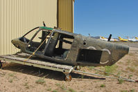 71-20576 @ IGM - Just the Cabin shell of accident victim 1971 Bell OH-58a, c/n: 41437 remains outside the Sheriff's Hangar at Kingman