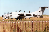 85-0154 @ EGQS - RC-12K Huron, callsign Argus 2 Alpha, of the 1st Military Intelligence Battalion taxying to Runway 05 at RAF Lossiemouth in September 1994. - by Peter Nicholson
