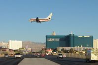 N288DP @ LAS - Janet Airlines' Boeing 737-66N, c/n: 29892 crosses Tropicana Avenue heading for Runway 19 landing at Las Vegas
