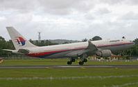 9M-MKV @ WADD - Malaysia Airlines - by Lutomo Edy Permono