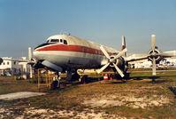 N1097 @ 34AZ - Opa Locka , DC-7B - by Henk Geerlings