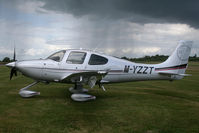 M-YZZT @ EGBT - With a passing shower behind - by N-A-S