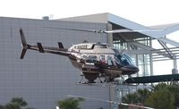 N175MS - Bell 206 leaving Heliexpo Orlando