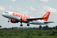 G-EZEI @ EHAM - EasyJet A319 taking off from Schiphol airport. - by Henk van Capelle