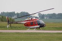 162677 @ KDVN - Parked on runway - by Glenn E. Chatfield