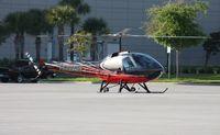 N962SM - Enstrom 280FX leaving Heliexpo Orlando