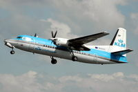 PH-KVC @ EHAM - KLM Fokker 50 retracting its landing gear after take off from Schiphol airport. - by Henk van Capelle