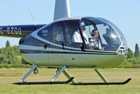 G-BZGO @ EGCB - 2000 Robinson R44 Astro, c/n: 0757 giving helicopter joy rides at Open Day - this lad looked as if he really enjoyed himself