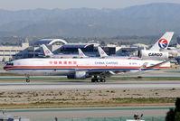 B-2174 @ KLAX - 25Left arrival - by Bob Grandolfo