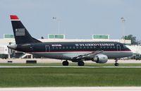 N802MD @ SRQ - US Airways Express E170