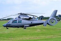 G-DPHN @ EGBT - being used for ferrying race fans to the British F1 Grand Prix at Silverstone - by Chris Hall