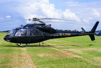 G-LENI @ EGBT - being used for ferrying race fans to the British F1 Grand Prix at Silverstone - by Chris Hall