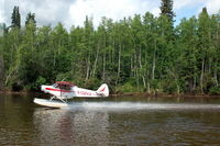 N1324A - 1951 Piper PA18-125 Float Plane on the Chena River at Fairbanks, AK - by scotch-canadian